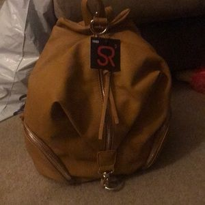 Handbags - Julian style backpack from posh (non leather )